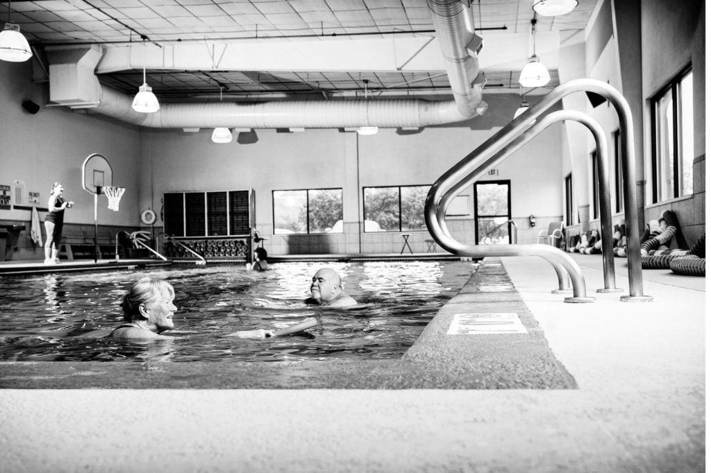 Poolside view of seniors swimming