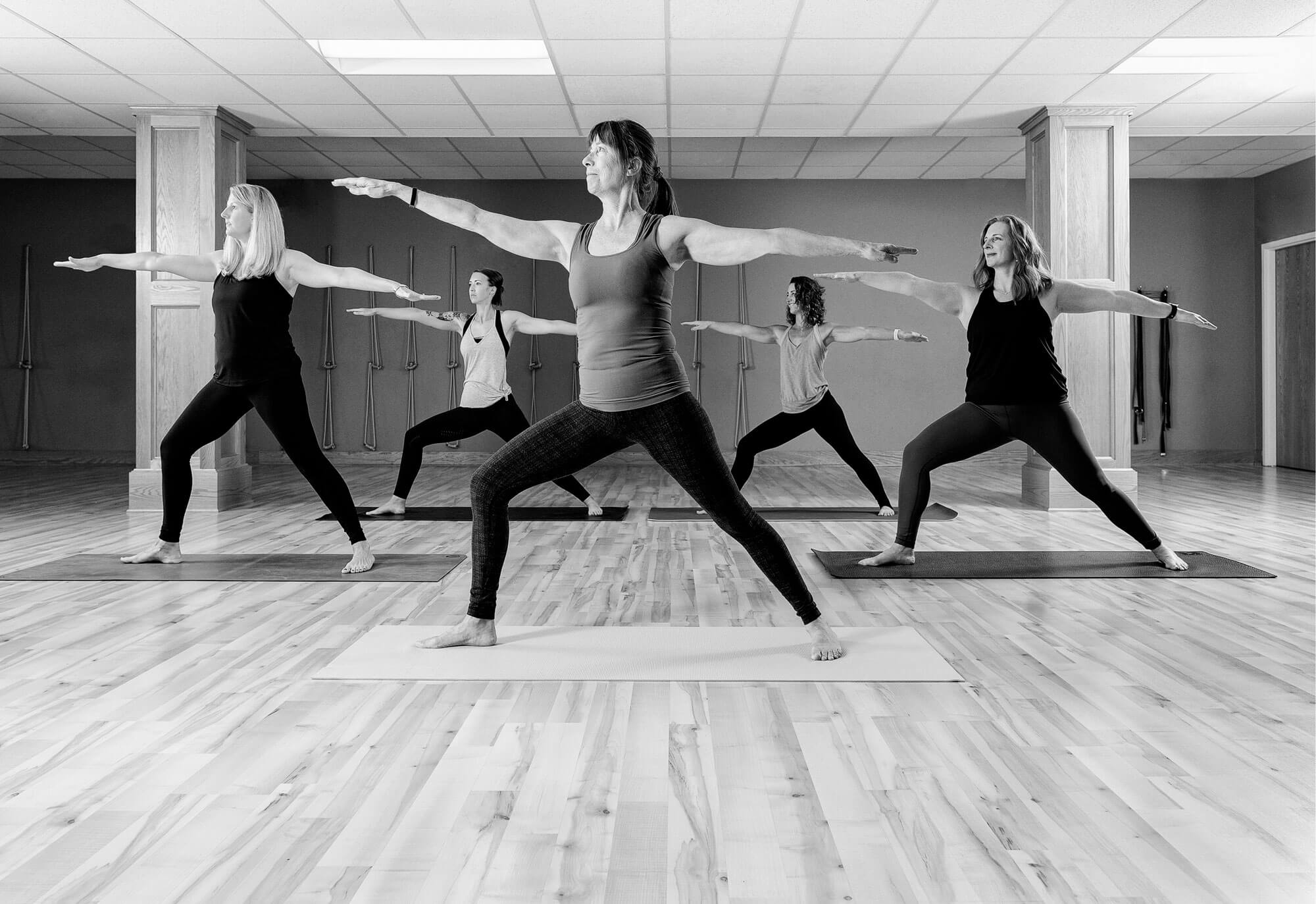 Yoga class in the middle of a pose
